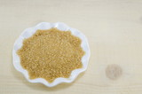 Brown sugar in a white plate