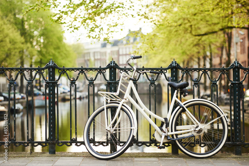 bike on amsterdam street in city Poster
