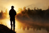 Fototapety fisher fishing on foggy sunrise