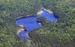 Aerial view of a lake in the middle of wild canadian forest