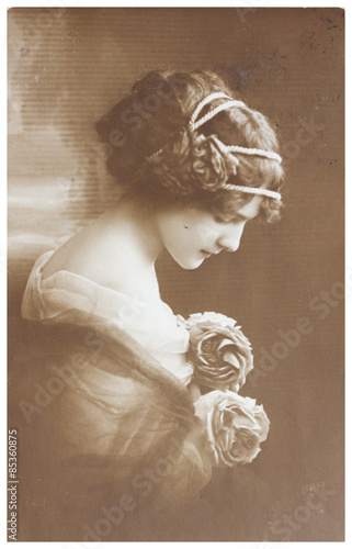 Vintage photo portrait of young woman © neirfy