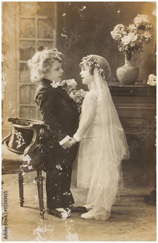 Vintage photo  of cute children in wedding dress Poster