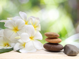 Fototapety Zen spa concept background - Zen massage stones with frangipani plumeria flower