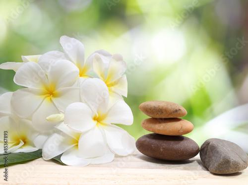 Zen spa concept background - Zen massage stones with frangipani plumeria flower - 85367893