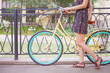 beautiful woman dressed in fashion dress travel by vintage bicycle