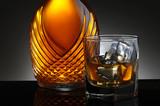 Glass of Scotch and Elegant Decanter
