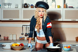 Blonde girl in the kitchen.