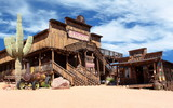 Fototapety Old Wild West desert cowboy town with cactus and saloon