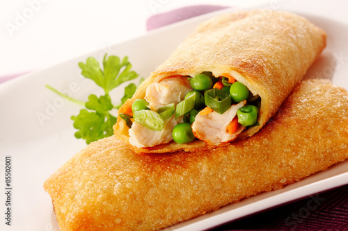 Tasty crispy spring roll with crab and peas