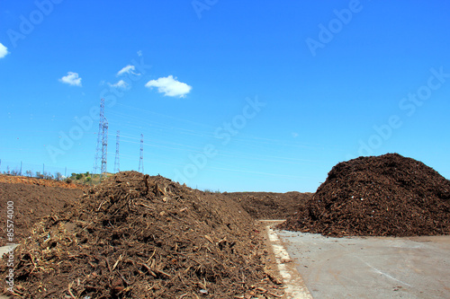 Staande foto Industrial geb. Piles of compost at a green recycle plant