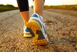 Fototapeta Woman's  athletic legs .Close up image of sneakers.Jogging.