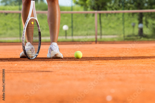 Plakat Legs of female tennis player.Close up image.