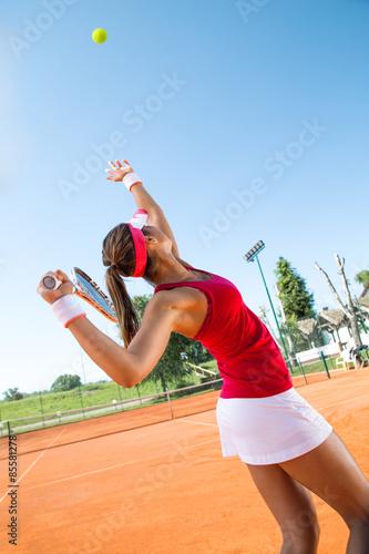Plakát Female tennis player serving a tennis ball