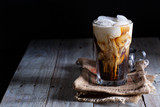 Fototapety Iced coffee in a tall glass
