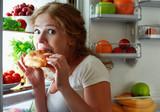 Fototapety Woman eats night stole the refrigerator