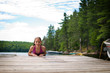 young teenage girl on a dock at a lake in Ontario's cottage country