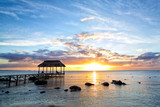 Beautiful sunset with jetty in Mauritius Island