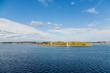 White Lighthouse Across Blue Bay