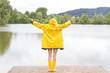 Happy woman in the rain