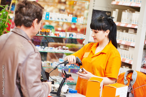 assistant cashier works with buyer shop