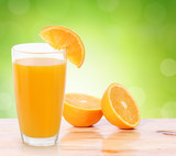 Fotoroleta Orange juice on  wood