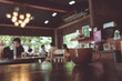 vintage tone of cup of coffee on table in Coffee shop blur backg