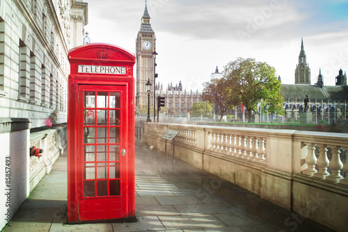 Big ben and red phone cabine in London Poster