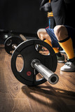 Bodybuilding, Closeup  Barbell in GYM studio - 85873267