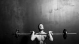 Bodybuilding, Young Athletic Strong Man Weightlifting , Black and White in studio - 85873297