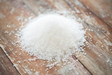 close up of white salt heap on wooden table
