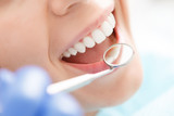 Close-up of woman having her teeth examined
