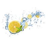Lemons slices in water splashes on white