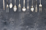 Fototapety Silver cutlery on the dark wood
