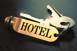 Fototapety Hotel - Bunch of Keys with Text on Golden Keychain.
