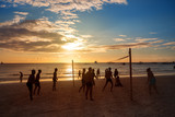Fototapeta Silhouette people playing volleyball