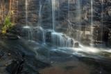 Fotoroleta Waterfall on rocks below