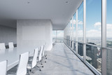 Modern panoramic conference room. A white rectangular table and chairs around it. New York City view. - 85982294