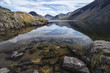 roleta: Stunning landscape of Wast Water with reflections in calm lake w