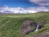 Fototapeta Waterfall and Mountains