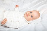 Infant in baptismal clothes