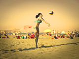 Girl playing beach volley at the seaside