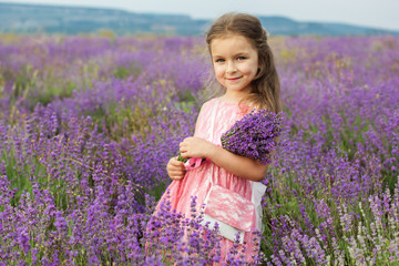 Cute little child girl in meadow of lavender
