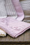 Crochet, Cable Knit Baby Blanket on Sofa , Closeup Soft Focus High Contrast - 86193654
