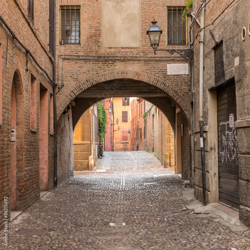 Obraz na Szkle Ancient medieval street in the downtown of Ferrara city