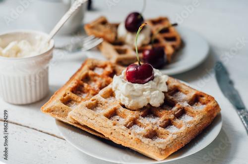 Foto op Plexiglas Brussel Breakfast with wholegrain waffles and whipped cream
