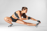 Fototapety sportswoman doing stretching exercise, warm up