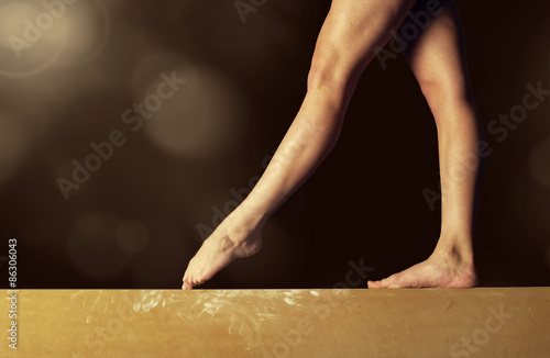Close view of a Gymnast legs on a balance beam Poster