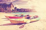 Fototapety Retro toned kayaks on a tropical beach.