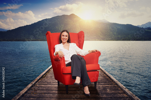 Poster woman on the red chair on moorage
