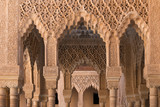 Moorish arches and columns of Alhambra harem in Granada, Spain